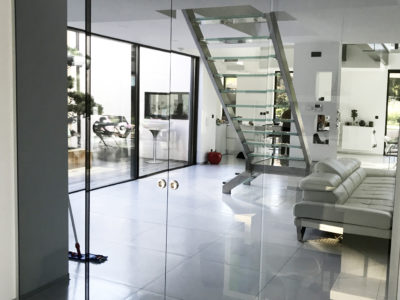 stopsol reflective glass sliding door