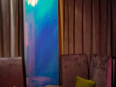 Dichroic decorative laminated glass partition