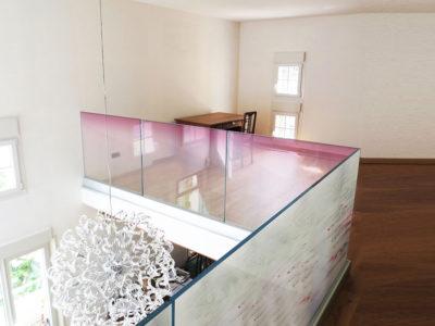 Glass railing for mezzanine